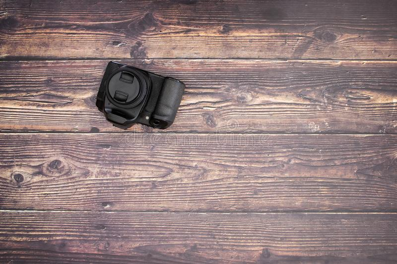 DSL camera on the wooden table.  stock photo