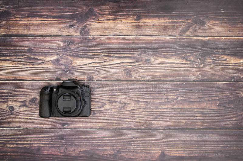 DSL camera on the wooden table.  stock image