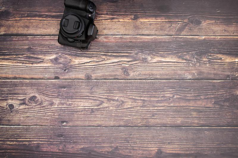 DSL camera on the wooden table.  stock images