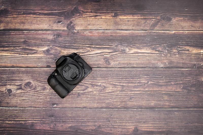 DSL camera on the wooden table.  royalty free stock image