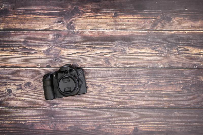 DSL camera on the wooden table.  stock photos