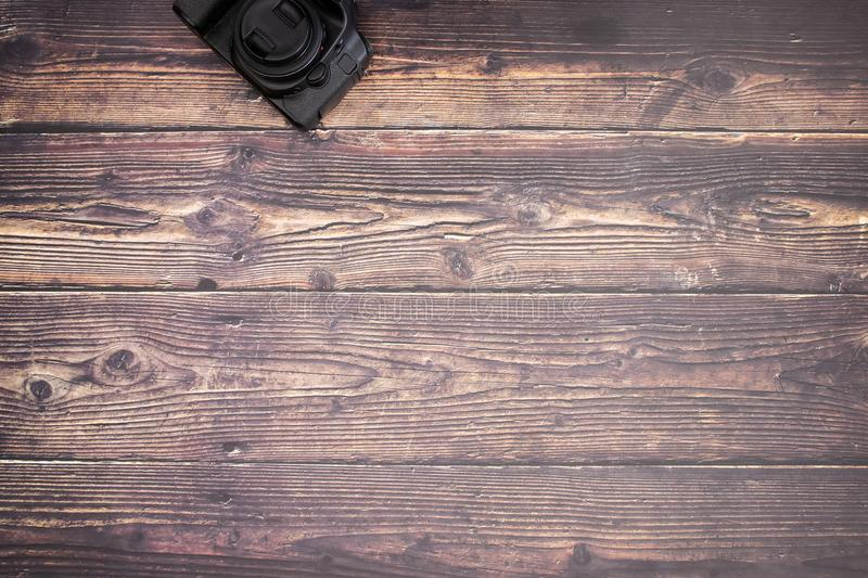 DSL camera on the wooden table.  royalty free stock photos