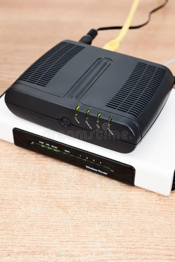 Free Dsl Modem With Router And Cables Royalty Free Stock Photos - 12965518