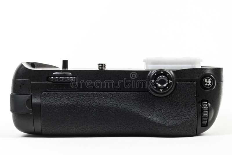 DSLR camera battery grip color black isolated in white. Back view. royalty free stock image