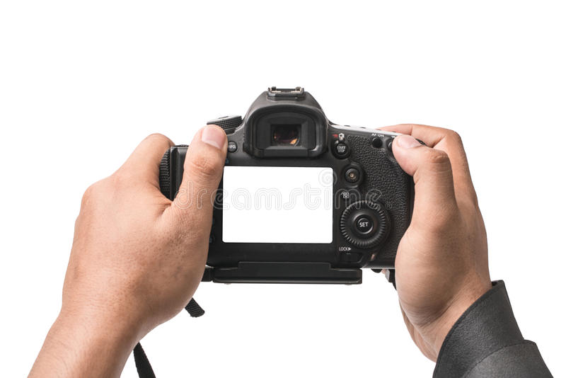 DSLR camera in hand isolated royalty free stock images