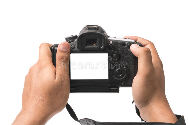 DSLR camera in hand isolated royalty free stock photography