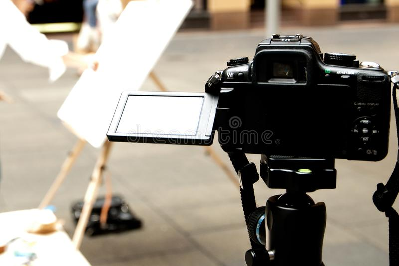 DSLR camera monitor when it flips up on the tripod. A DSLR camera monitor when it flips up on the tripod royalty free stock images