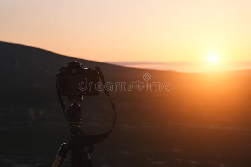 DSLR camera mounted on a tripod. Shooting the sunset scenery royalty free stock images