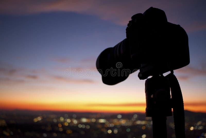 DSLR camera silhouette-sunset royalty free stock image