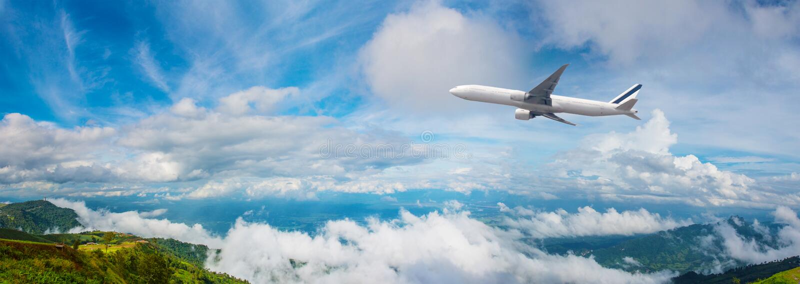 DSLR camera taking travel nature photography. full frame camera on tripod take photograph of airplane take off with beautiful lan. Dscape in background. DSLR stock photos