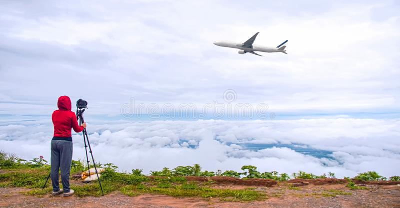 DSLR camera taking travel nature photography. full frame camera on tripod take photograph of airplane take off with beautiful lan. Dscape in background. DSLR royalty free stock images