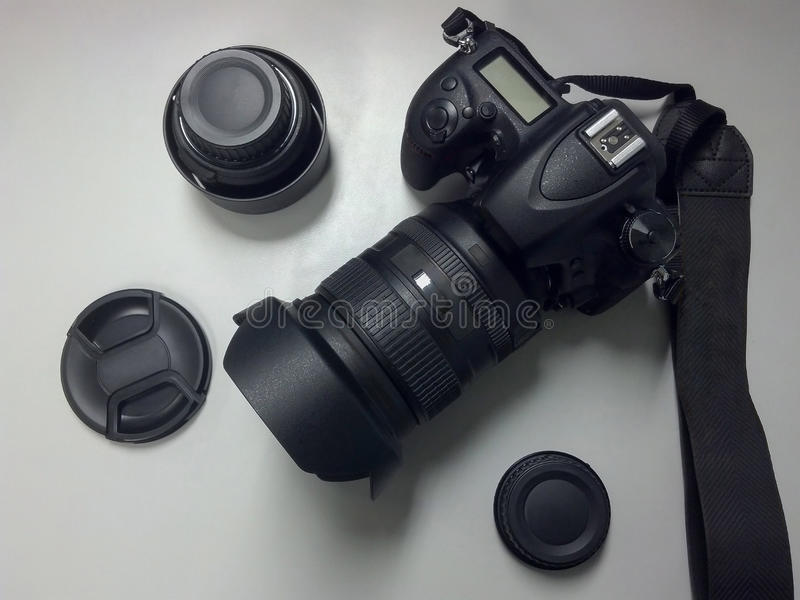 DSLR Camera Top View With Lens And Accessories. Black DSLR Camera Top View With Lens And Accessories royalty free stock photos