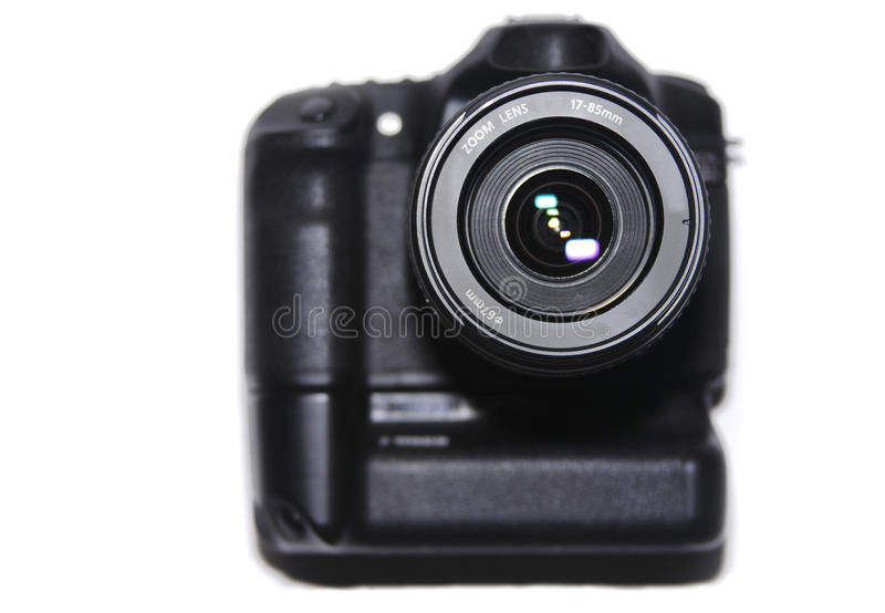 DSLR Digital Camera. A modern DSLR digital camera and lens isolated on white royalty free stock photos