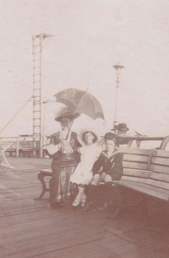 DT00039 Beach Scene -Sea Shore Promenade - 1900 Mother with her Children royalty free stock photography