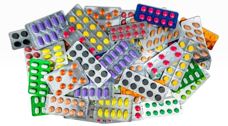 Dużo pastylek pigułki odizolowywać na białym tle Kolor żółty, purpura, czerń, pomarańcze, menchia, zielone pastylek pigułki w bąb obraz stock