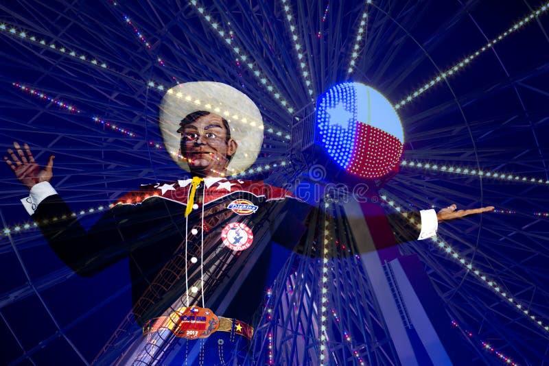 Duży Tex i Ferris koło przy nocą zdjęcia stock