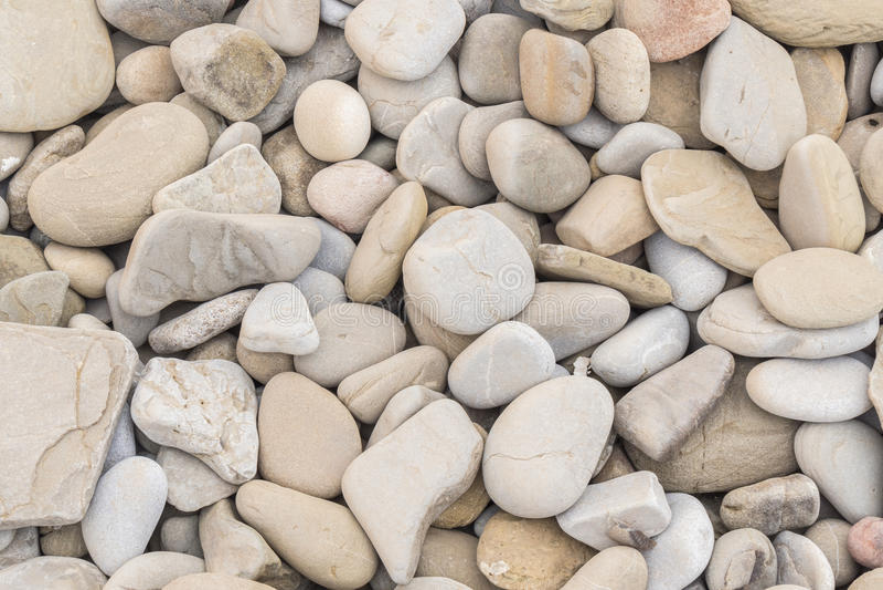 Dużych ilości zaokrąglać i polerować plażowe skały obraz royalty free