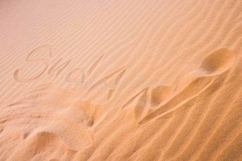 ` Du Soudan de ` écrit en sable images libres de droits