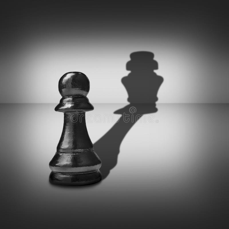 Dual Identity With A Pawn Casting A King Shadow Royalty Free Stock Photography
