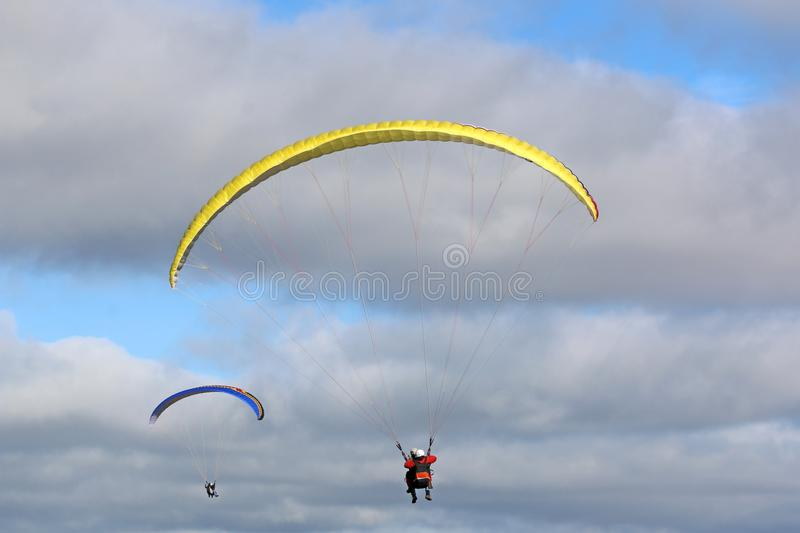 Tandem Paraglider in a blue sky stock photography