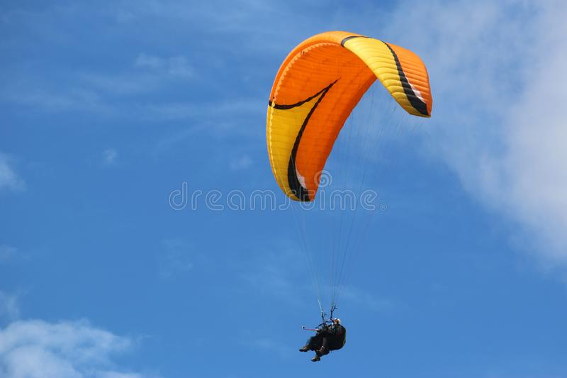 Tandem Paraglider in a blue sky stock photos