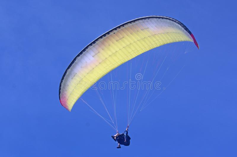 Tandem Paraglider in a blue sky royalty free stock image