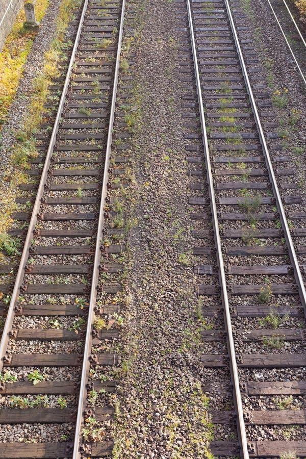 Dual Railway Tracks. Two parallel railway tracks in embankment of gravel royalty free stock photo