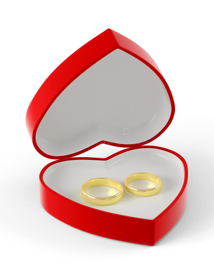 Duas alianças de casamento do ouro que encontram-se em uma caixa coração-dada forma vermelha imagens de stock