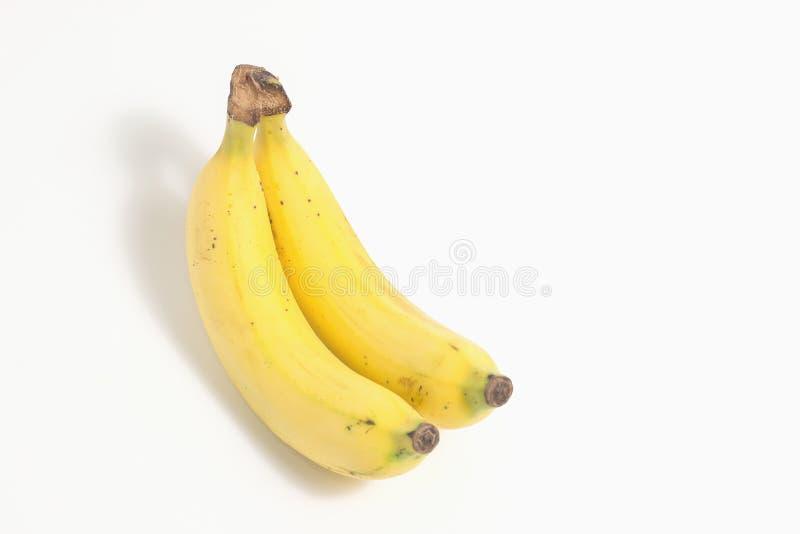 Duas bananas isoladas no fundo branco imagens de stock