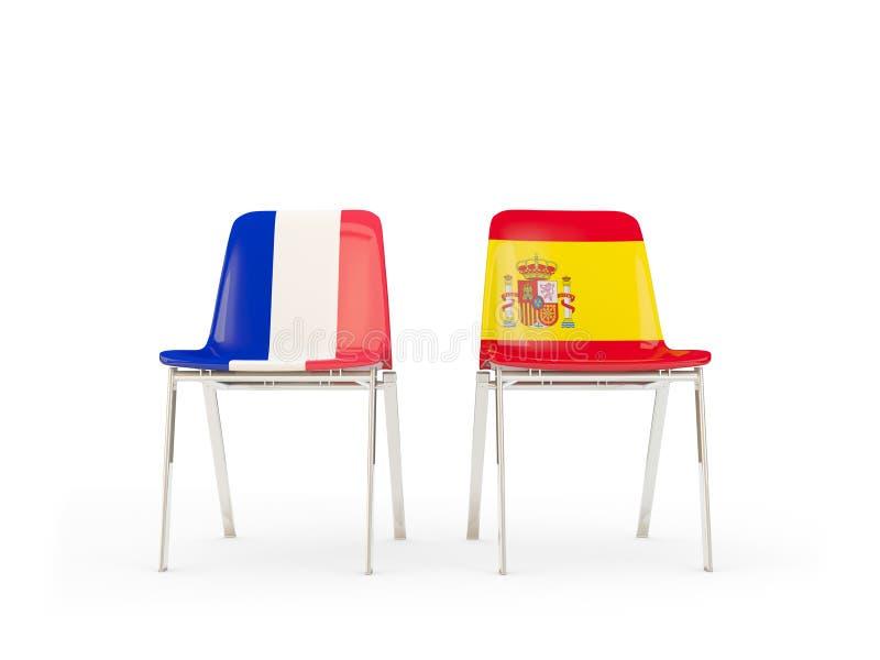 Duas cadeiras com as bandeiras de França e de spain ilustração royalty free