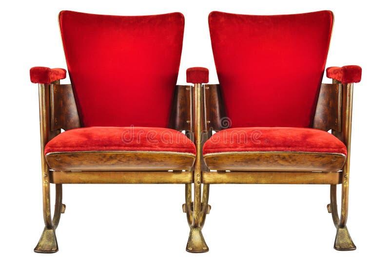 Duas cadeiras do cinema do vintage isoladas no branco imagem de stock
