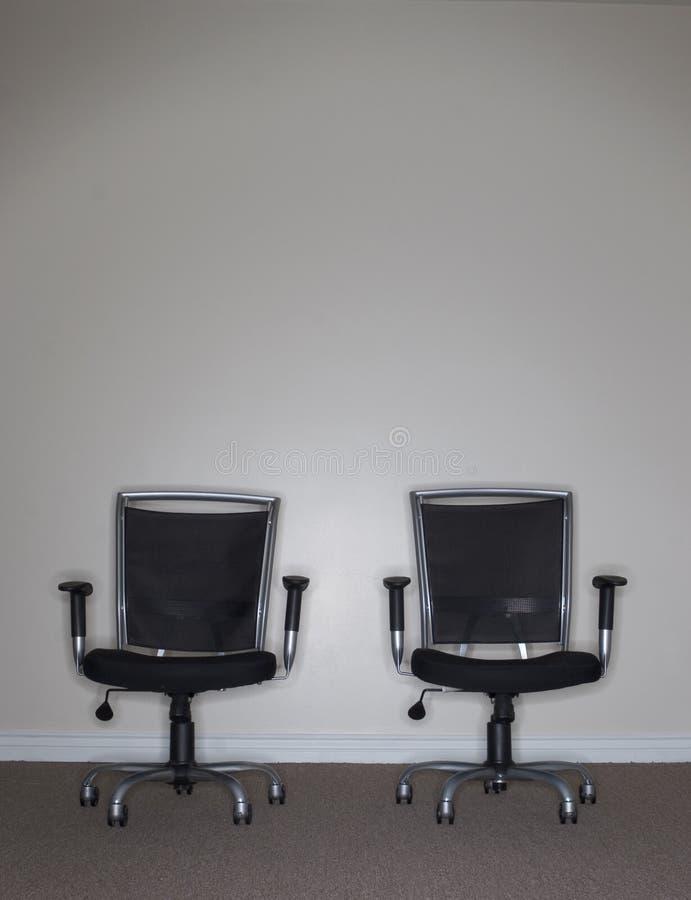 Duas cadeiras do negócio foto de stock royalty free