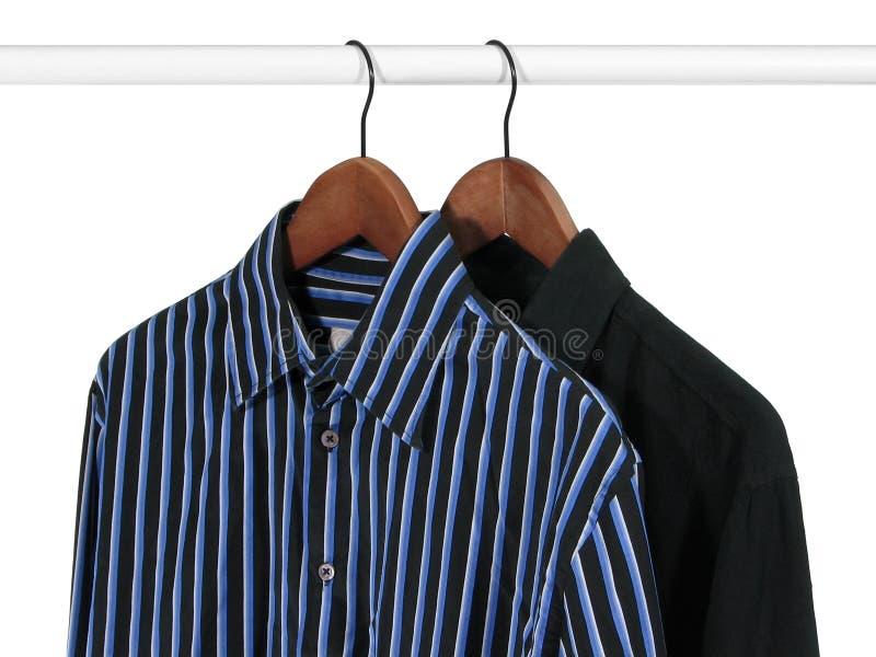 Duas camisas em uma cremalheira foto de stock royalty free