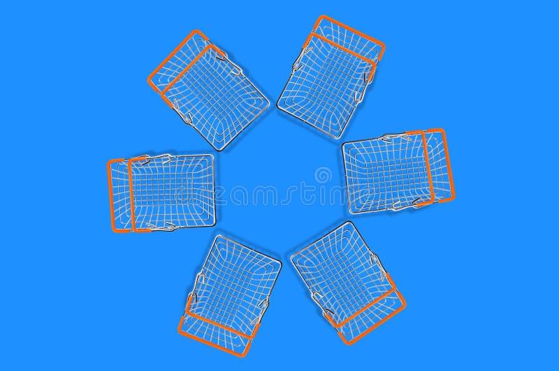 Duas cestas vazias do mercado fizeram do fio de metal do cromo e dos punhos de borracha alaranjados que encontram-se no formulári imagem de stock royalty free