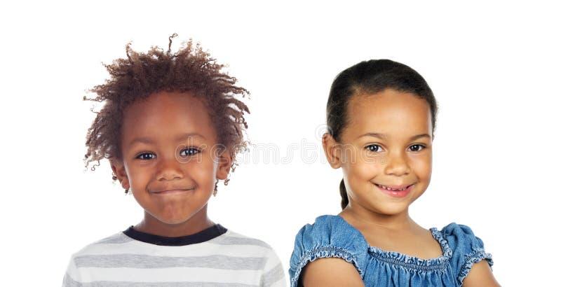 Duas crianças adoráveis do africano e do latino fotos de stock royalty free