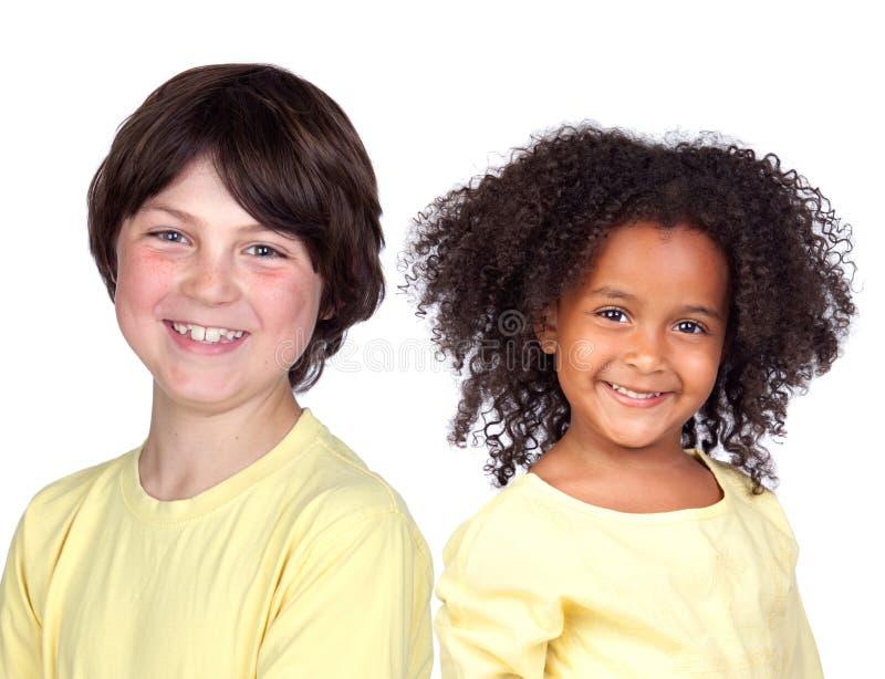 Duas crianças bonitas no amarelo imagem de stock royalty free