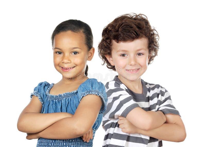 Duas crianças de raças diferentes imagens de stock