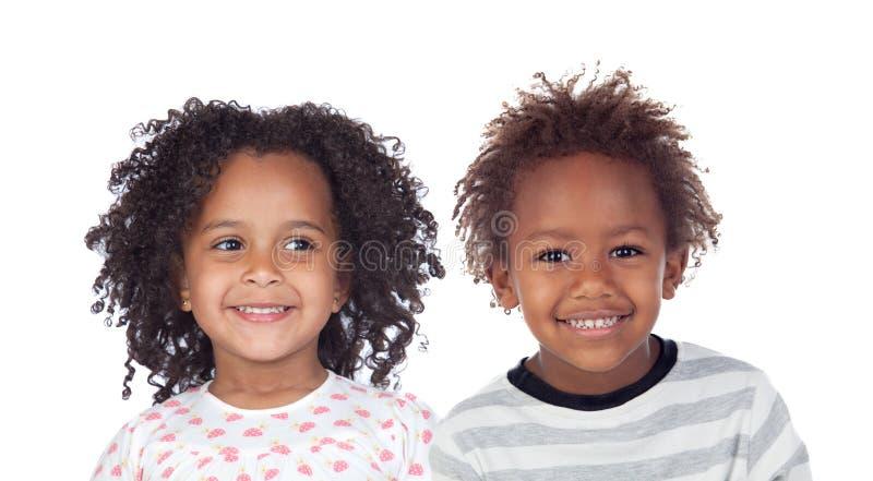 Duas crian?as afro-americanas imagem de stock royalty free