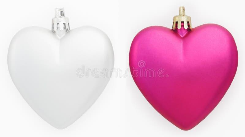 Duas decorações do Natal dos corações isoladas no branco imagem de stock royalty free
