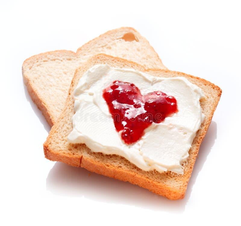 Duas fatias de pão com doce e manteiga fotografia de stock