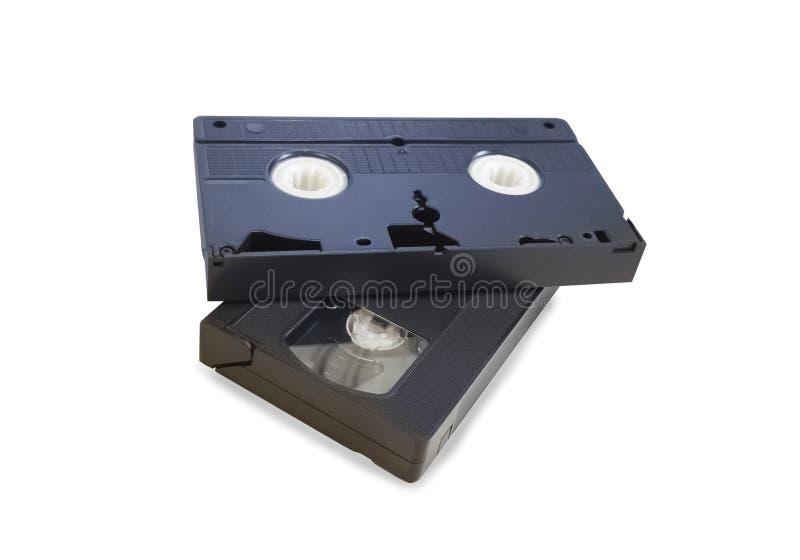 Duas fitas pretas velhas de VHS isoladas imagem de stock