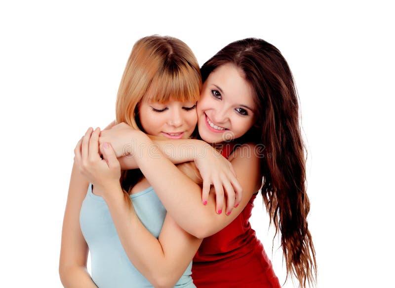 Duas irmãs adolescentes isoladas foto de stock