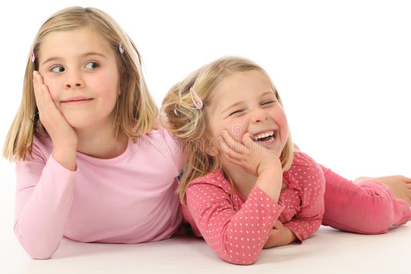 Duas irmãs da menina fotografia de stock royalty free