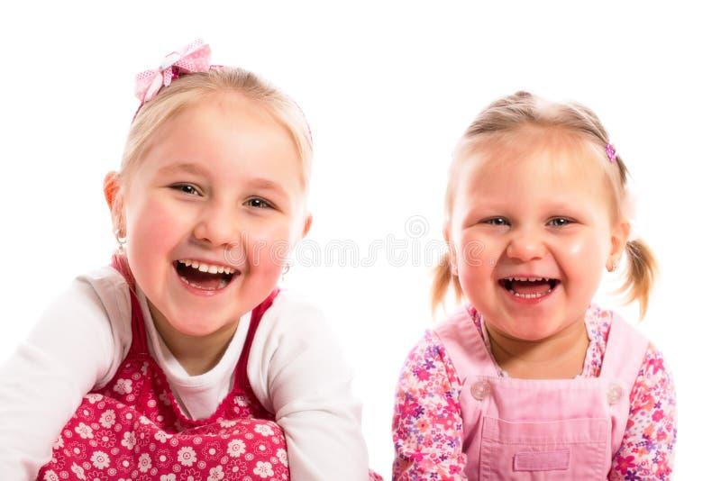 Duas irmãs de riso foto de stock royalty free