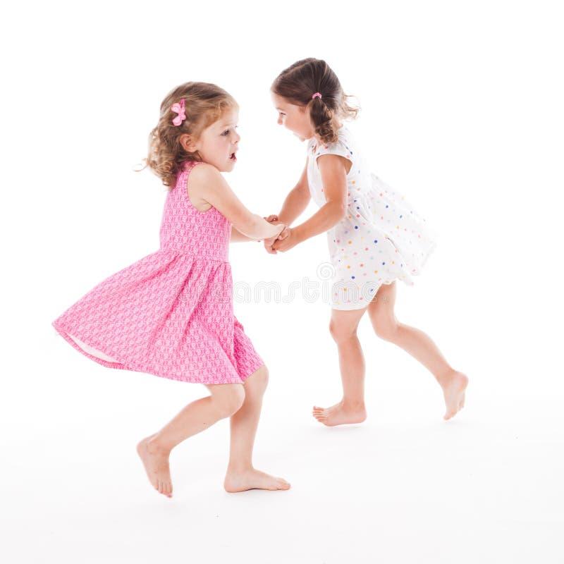 Duas irmãs isoladas imagens de stock royalty free