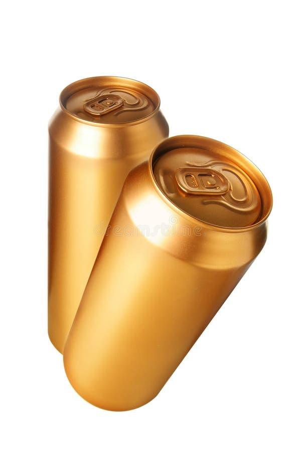 Duas latas de cerveja do ouro imagem de stock