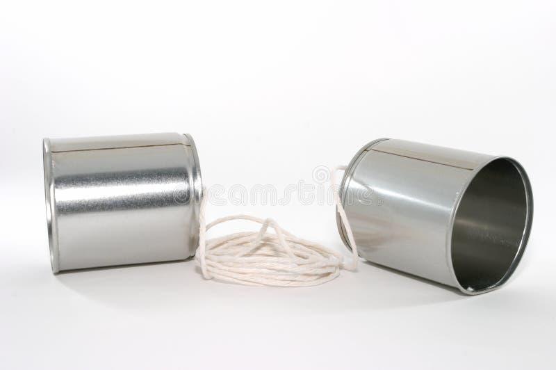 Duas latas e uma corda telefonam imagens de stock royalty free
