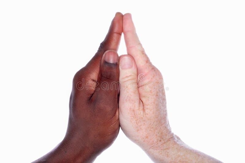Duas mãos que dão forma a uma igreja com um Steeple (baseado em han de uma criança fotos de stock