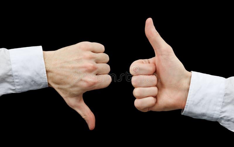 Duas mãos que mostram gestos manuseiam acima & manuseiam para baixo imagem de stock
