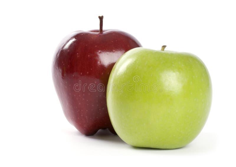 Duas maçãs isoladas no branco imagem de stock